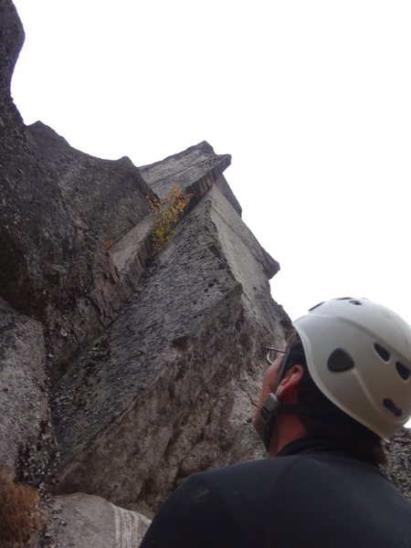 "Ben Smith, at the belay ledge on top of ""Entrance Crack"" considering where to go for a second pitch."