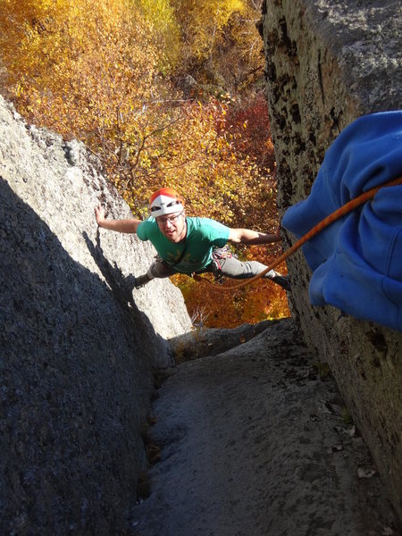 """Chuck Drew working out the moves of """"Stem It"""" 5.10d.  The route was TR'ed because it is overgrown at the moment."""