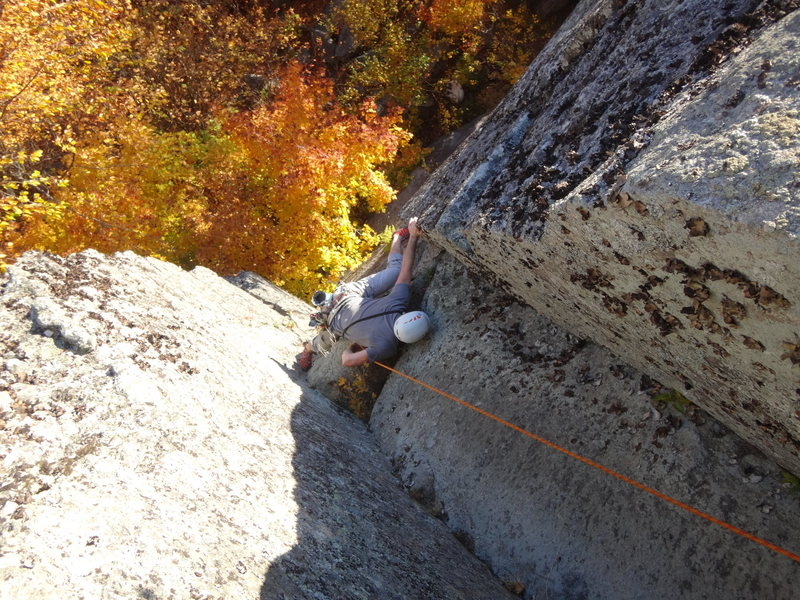 """James Puckett on the crux mantle about halfway up """"Stem It,"""" 5.10d."""