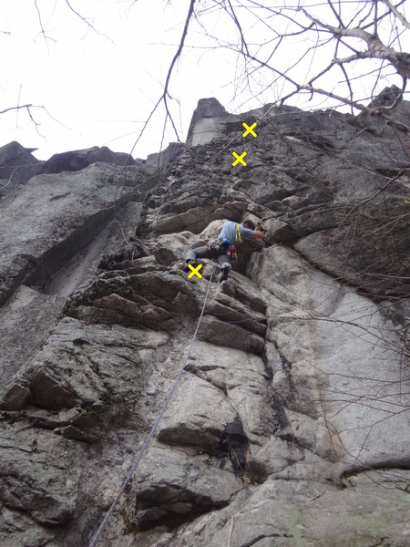 """Chuck Drew leading """"Plumbago,"""" 5.10a on a wet day."""