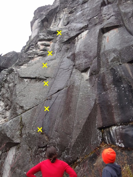 Looking up at Kennebago, 5.11c on a very wet day.