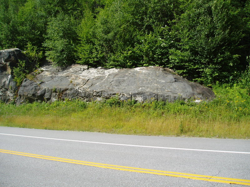 Climber&@POUND@39@SEMICOLON@s path to West End starts just right of this road blasted rock.
