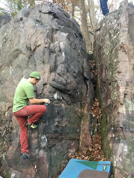 Pot Mouth climbs the face around the arete to the right of Baker.