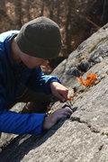 Rock Climbing Photo: Ken fishing in another nut.