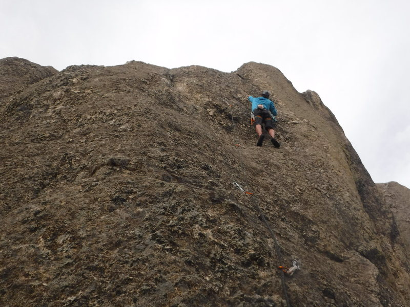 From the high saddle that splits Monster proper, start up and right on the line of bolts.