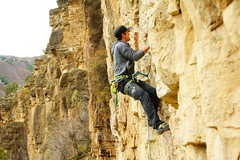 Rock Climbing Photo: Working the crux move up to the 4th bolt.