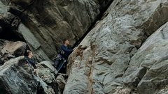 Rock Climbing Photo: Caleb sizes up the mantle move off the second bela...