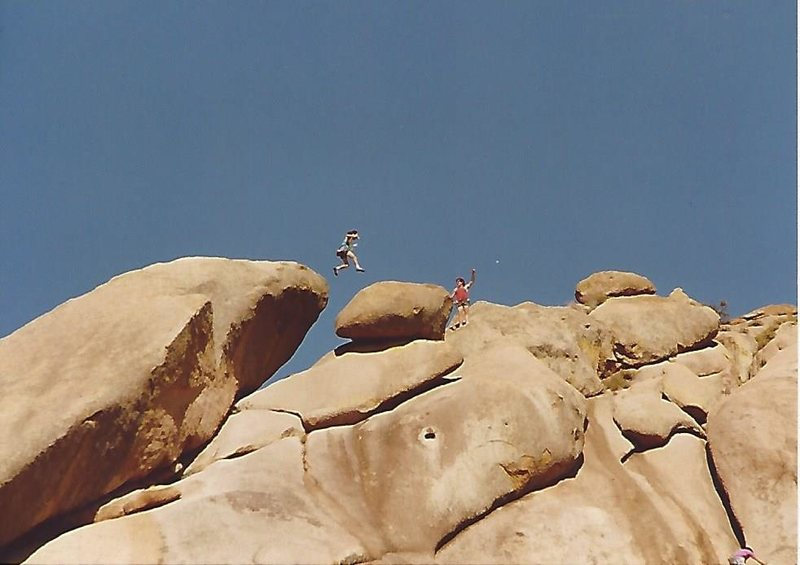 Brian Jung mid leap from the snakes head to the boulder
