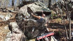 Rock Climbing Photo: Getting right hand to solid hold on prow.