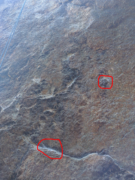 Beginning of the route. Red circles denote suggested starting handholds.