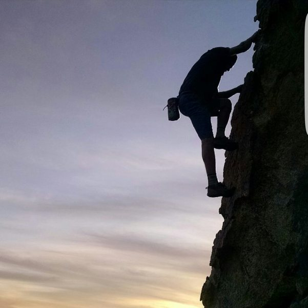 Rock Climbing Photo: James darden free soloing in garner at sunset