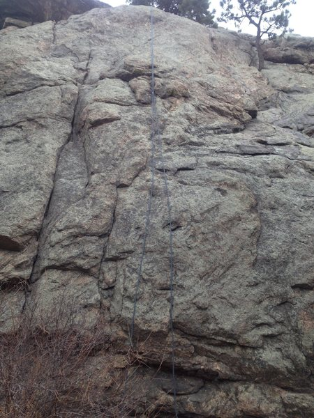 A view of the route with a rope hanging on it.