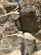 Rock Climbing Photo: Looking up, this shows the thin seam of the direct...
