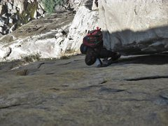 Rock Climbing Photo: Maxime wedges in a left shoulder and gets feet on ...