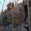 This is THE boulder of the area. It&@POUND@39@SEMICOLON@s 10-17 feet tall and 25-50 degrees overhanging. The rock is extremely high quality trap rock with great friction. Off the Chopping Block (V6) in yellow, project in blue, HARD project in red and highball project in purple. There is also potential for very hard low starts