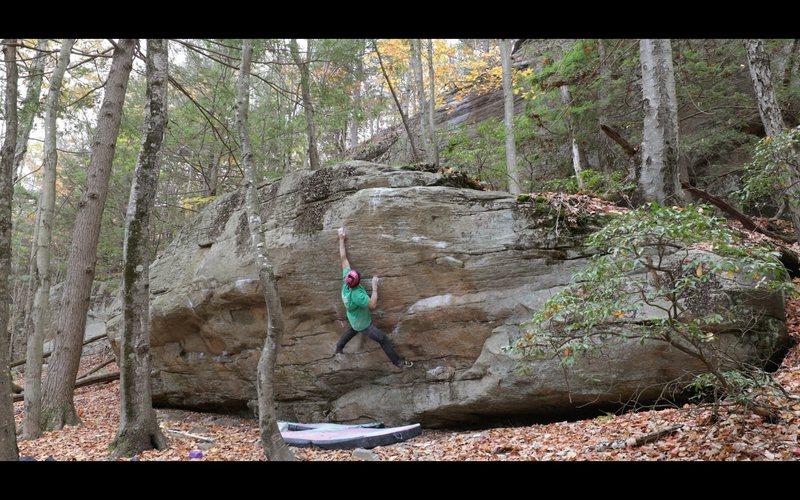 The long move to the crimp on 'Tips Away' (V7/8).