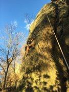 Nick climbing Northwest Buttress Direct on beautiful fall day.