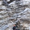 Craig Mohr chalking up at the first crux.