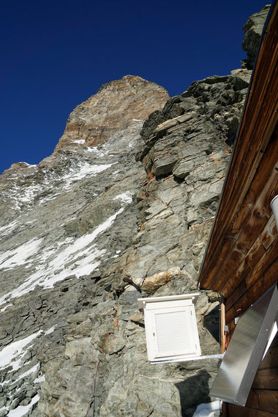 The tower above the Solvay Hut. The route turns it on the left via the Upper Moseley slab.<br> <br>