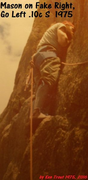 Hippie hardman Mason Frichette gardening a crack for pro on a first ascent at Mickey Mouse.