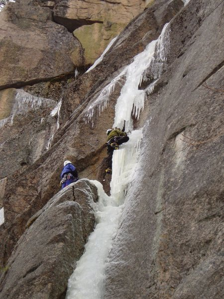 Rock Climbing Photo: Starting P2 with plenty of ice in the crux crack a...