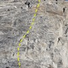 This route climbs the sport line to the left of the large rotten dihedral.