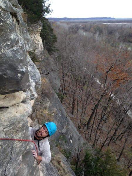 Terry, from Austin TX, enjoying the second ascent, following on familiar limestone