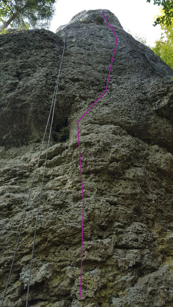 "Sempre Pace climbs the most direct line up the tower's south face (rope is on the anchors of ""Alter Weg"")"