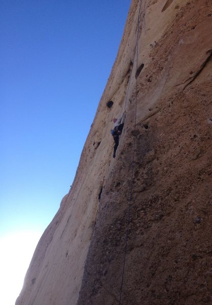 Mae reaching the crux on the Unknown 5.10a/b