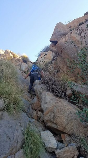 Scrambling up to routes in the upper limbo area