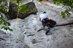 "Climber on the picture is on ""aquella"" both routes start with the same 2 bolts"