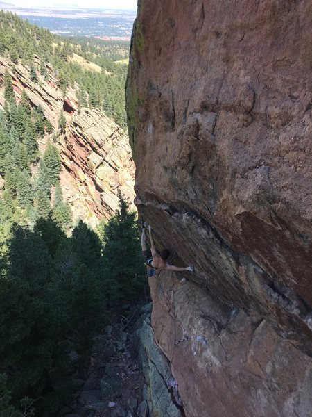"""Mike Patz working the first crux, which is most likely THE crux, if you are shorter than say 5'10""""."""