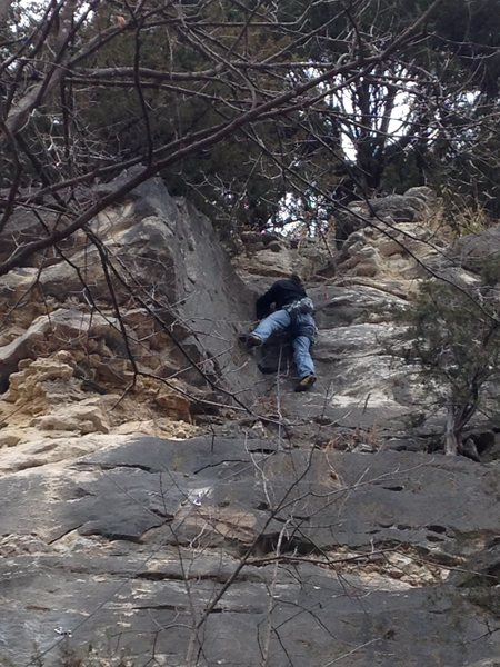 Greg climbing through upper dihedral