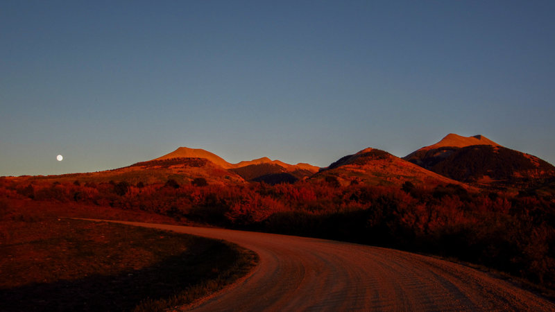 Moonrise over the La Sals in the fading alpenglow. September 2012