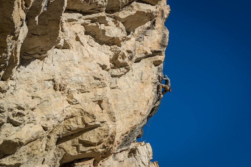 Nailing the red point crux on the second pitch.<br> <br> Photo by Luke Ross.