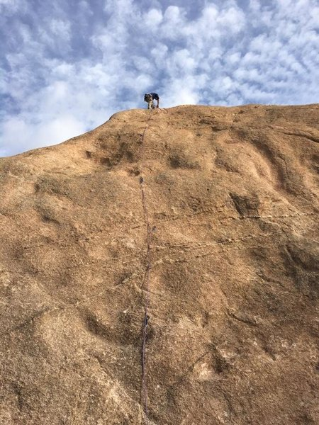 Setting up a rappell at the top of Peanut 2.