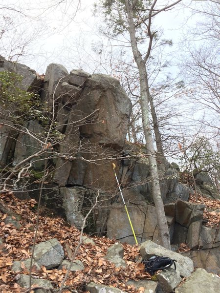 Tall, steep arete in the hillside of the left leg, off of the green and/or blue trail.