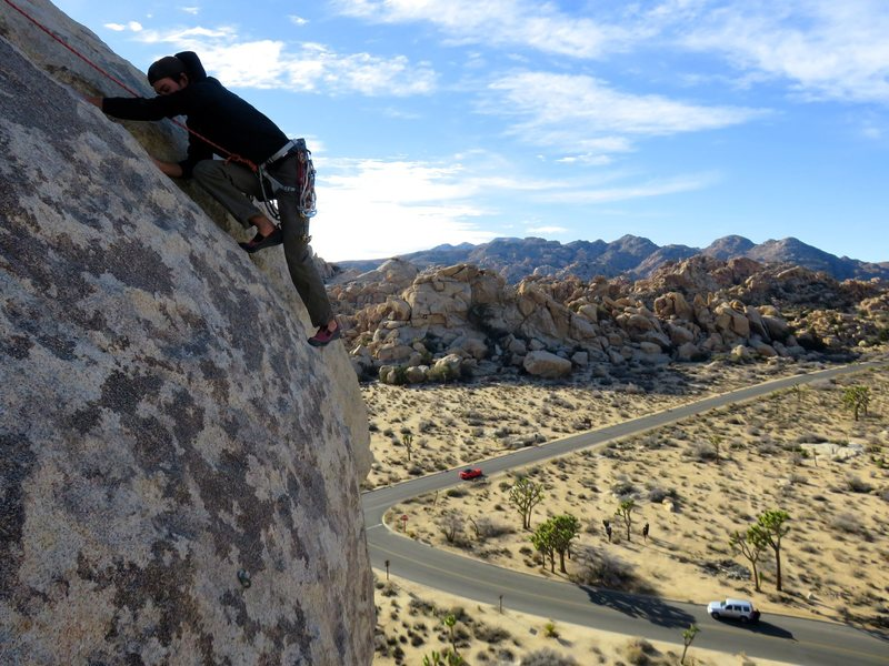 Rock Climbing Photo: Climber topping out on the final crack on North Ov...