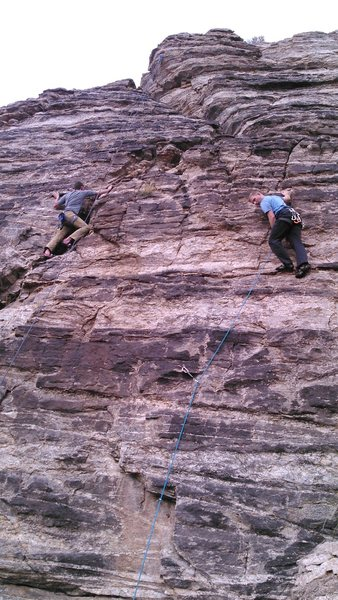 Climber on right is leading Birdman. Route follows the line of his rope and continues straight up past him to the chains.