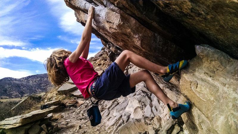 Norah Carrington bouldering in Morrison