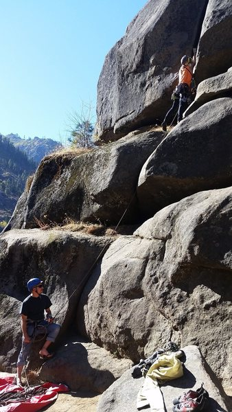 View of the route from the belay up to the start of the hand/fist crack where the difficulty begins.  I'm placing a BD #2 to protect the beginning of the hand/fist crack, after back cleaning a #3 from the bulge below my feet.