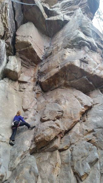 A view up Abeja. The two 5.10-ish cracks can be seen going through the large ceiling above the climber. <br> <br> This route is up and right from the Madonna in a large, dusty alcove (bring a rope bag or tarp).