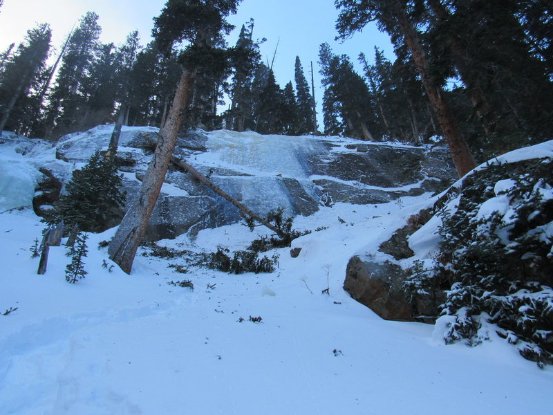 On 12/26/2016, my climbing partner and I encountered this large, fallen tree across some of the Jewel Lake ice. We suspect it was blown down from above in the massive windstorm the day before. Debris were found in the middle (see the log peeking out) and on top of the flow as well.