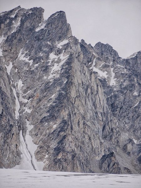 Funding Denied (5.10)<br> Route starts below the glacier&#39;s horizon on splitters before moving left to the prominent arete.