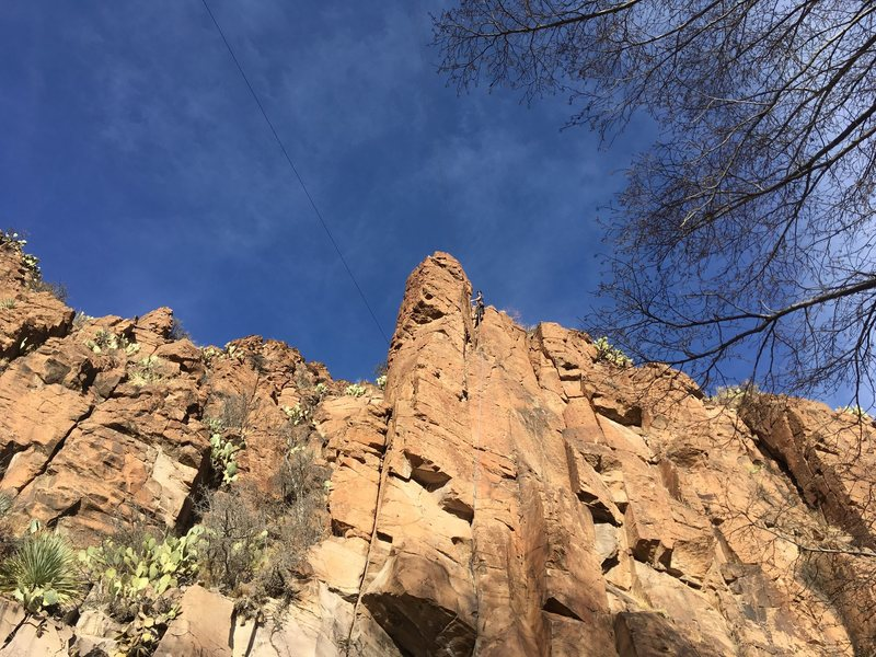 Upper portion of the route, with a climber (Michael Briseno) at the chains.