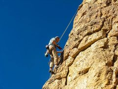 Rock Climbing Photo: Reggie cleaning and drilling the route.