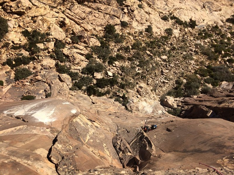 From the top of the 2nd pitch.  Large scar to the left of the climbers.  Debris trail directly below them.