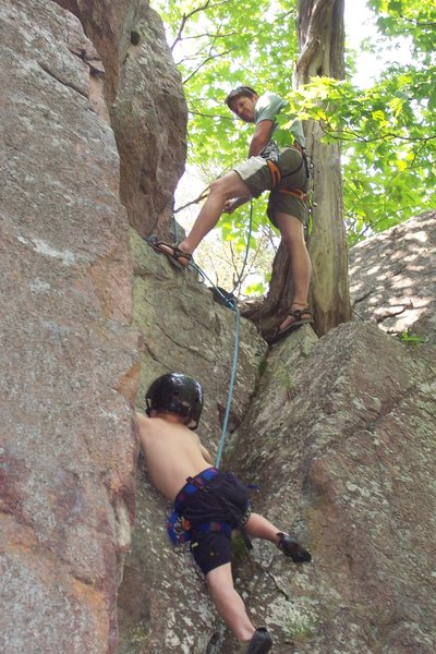 Marcus belaying Zach Godbey climbing up a crack along the Lower Pool Wall 2009