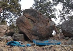 Start in the center of the boulder.