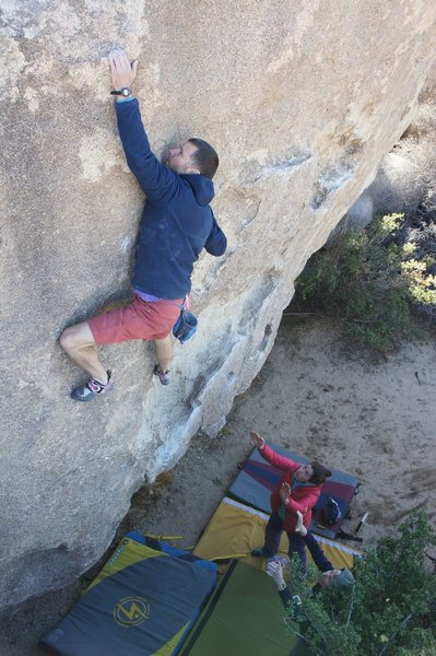 Pulling (if you can call it that) through the crux. Amazing problem. Credit to Mike Brady for the photo.
